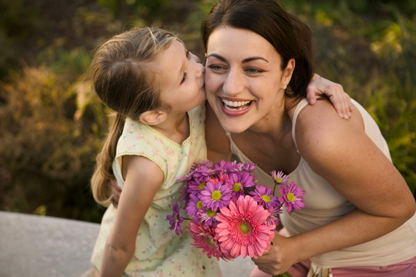Mum and Daughter with flowers